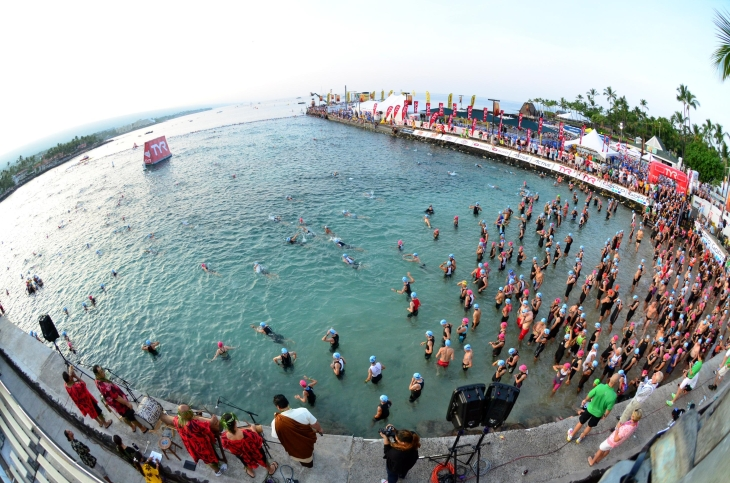 Athletes enter the water